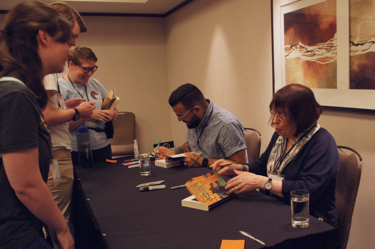 Diane and Mark signing books for attendees